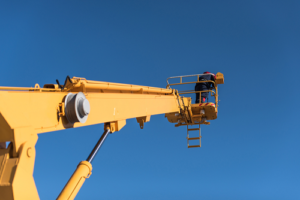 worker in bucket end of boom lift