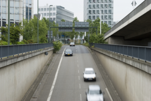 3 Cars driving over bridge