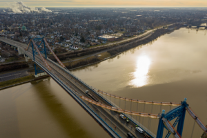 Aerial view of bridge with river and city below