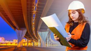 Female contractor standing underneath bridge