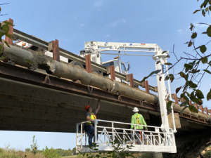 Bridge inspection maintenance carried out by 2 workmen onboard a Aspen a 30